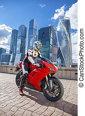 Young man sits on a sports bike on