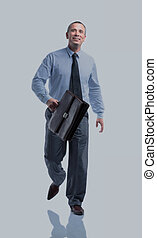 portrait in full height, smiling a qualified accountant with...
