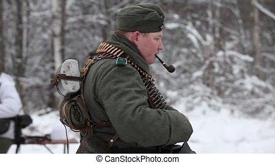 portrait machine gunner - German machine gunner smokes a...