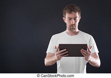 Portrait man with digital tablet