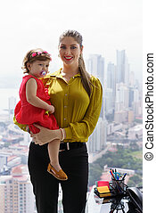 Portrait Manager Mother With Little Daughter In Office