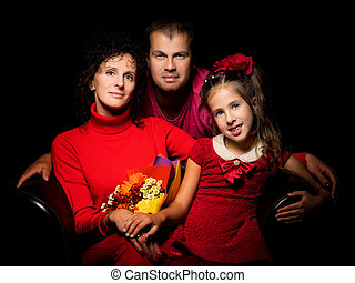Portrait, mom and dad with a little daughter.