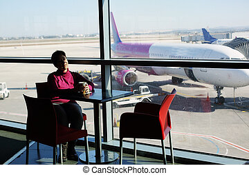 Portrait of 45 years old woman siiting in airport
