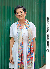 portrait of 45s years asian woman standing with toothy smiling face