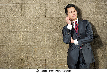 Portrait of a a Young Businessman on Phone