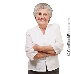 portrait of a adorable senior woman standing over white...