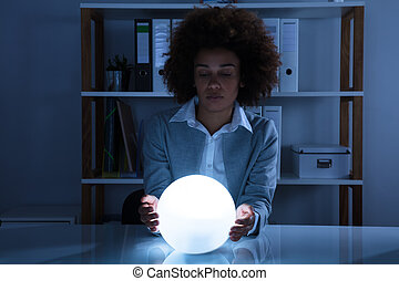 Businesswoman Hand On Crystal Ball