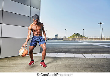 Portrait of a afroamerican man playing basketball in outdoor