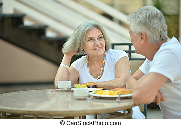 Portrait of a amusing old couple in cafe