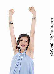 Portrait of a an excited young woman celebrating success over white background