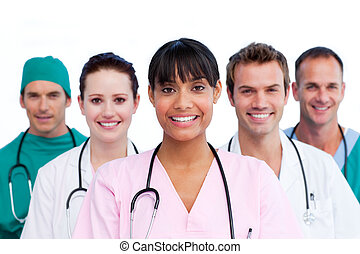Portrait of a assertive medical team against a white...