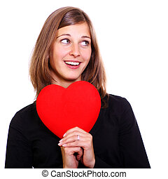 Portrait of a attractive young woman holding a red heart