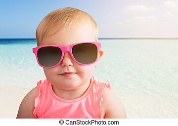 Portrait Of A Baby Girl Wearing Sunglasses