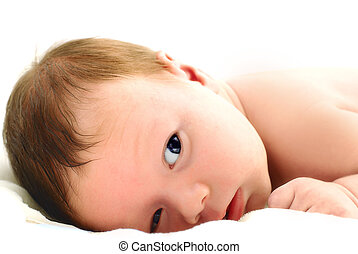 Portrait of a baby lying on white