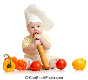 Portrait of a baby wearing a chef hat with healthy food...