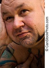 portrait of a bald man wi