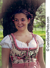 Portrait of a Bavarian girl in dirndl