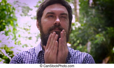 Portrait of a bearded man being dreamy or love struck -...