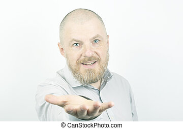 Portrait of a bearded man in a shirt with outstretched hand in soft light
