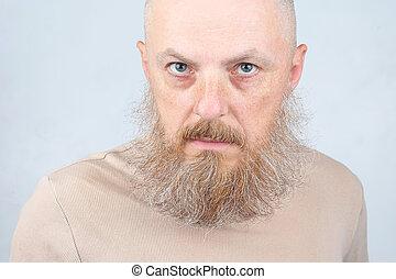 portrait of a bearded man on a light background