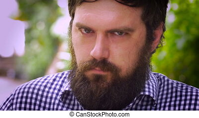 Portrait of a bearded man quietly being pissed off, angry, or mad