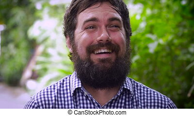 Portrait of a bearded man with laughing like he's crazy -...