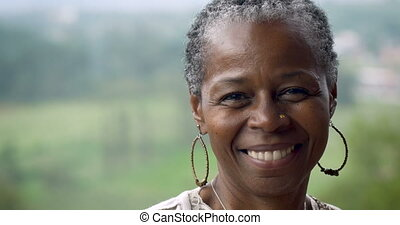 Portrait of a beautiful African American woman in her 60s smiling