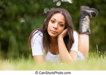 Portrait of a beautiful african young woman outdoors