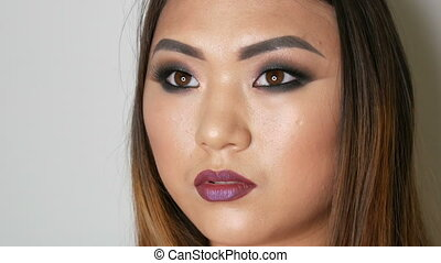Portrait of a beautiful Asian girl model with bright makeup...