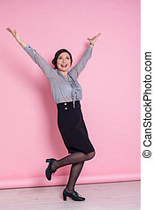 portrait of a beautiful Asian woman on a pink background