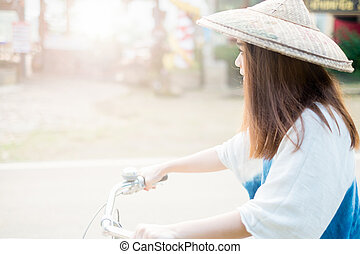Portrait of a beautiful asian woman with a bicycle