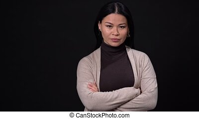 Portrait of a beautiful Asian woman with her arms crossed