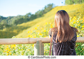 Portrait of a beautiful asian woman with nature background