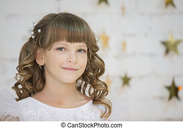 Portrait of a beautiful baby girl. Seven-year-old child. Primary school girl model