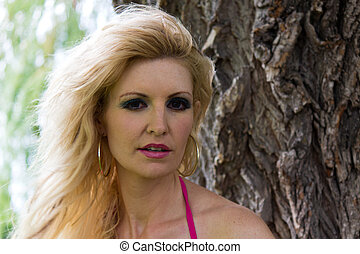 Portrait of a beautiful blond woman in the park.