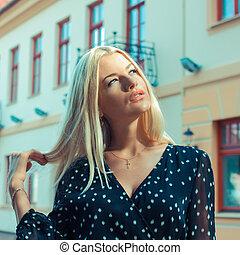 portrait of a beautiful blonde closeup spring
