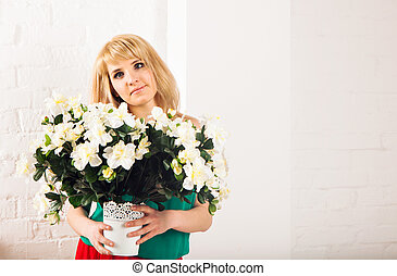 portrait of a beautiful blonde girl with a bouquet of flowers