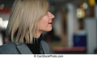 Portrait of a beautiful blonde girl with red lips