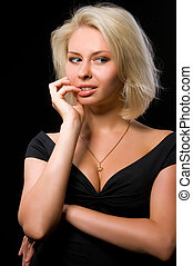 blonde woman on black background