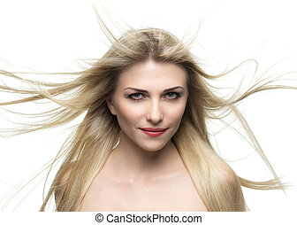 portrait of a beautiful blonde woman with hair fluttering in the wind isolated