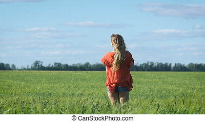 Portrait of a beautiful blonde young romantic woman in a red...