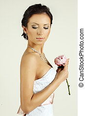 Portrait of a beautiful bride with flowers
