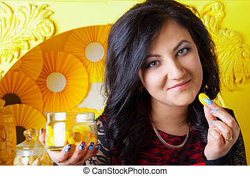 portrait of a beautiful brunette girl with candy