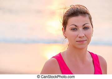 portrait of a beautiful brunette in a pink t-shirt