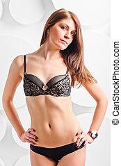 portrait of a beautiful brunette in lingerie