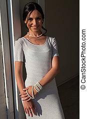 Portrait of a beautiful brunette woman in a dress