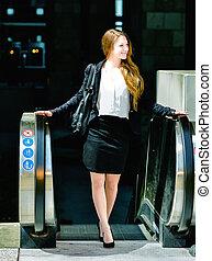 Portrait of a beautiful business woman on an escalator