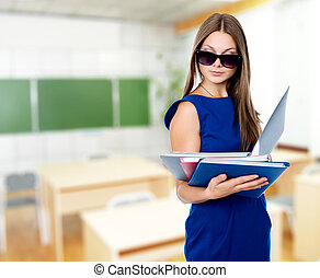 Portrait of a beautiful business woman with folders