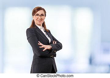 Portrait of a beautiful businesswoman 50 ears old in crossed...
