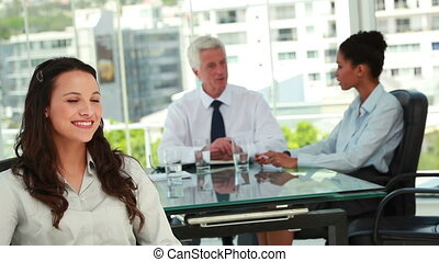 Portrait of a beautiful businesswoman with colleagues in background